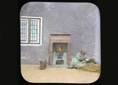 Slide shows a woman and boy in a bare house: University of Bristol Theatre Collection