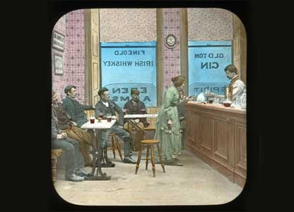 A scene from a pub with a woman at the bar :University of Bristol Theatre Collection