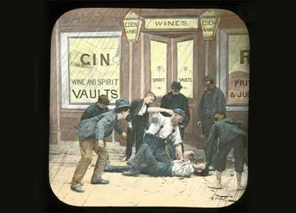 Lantern slide shows men brawling outside a pub: University of Bristol Theatre Collection