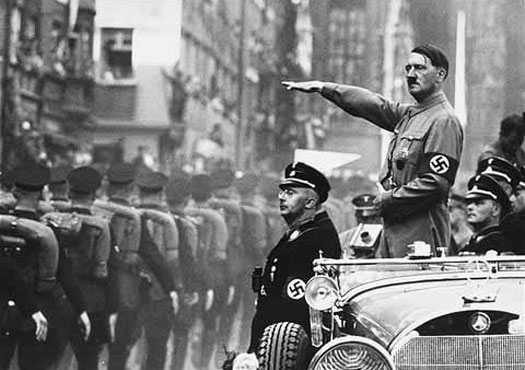 Adolf Hitler salutes his troops