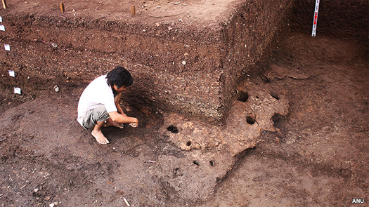 Archaeologists work at the Rach Nui site in Vietnam