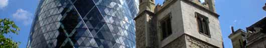 St Andrew Undershaft beneath the towering 'Gherkin' in the City of London